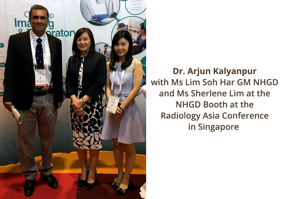 Dr Arjun Kalyanpur with Ms Lim Soh Har GM NHGD and Ms Sherlene Lim at the NHGD Booth at the Radiology Asia Conference in Singapore